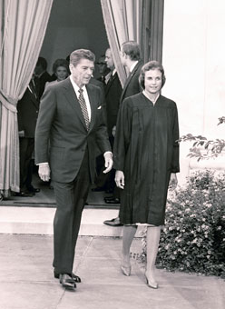 President Ronald Reagan and Justice Sandra Day O'Connor walk outside the Supreme Court after O'Connor was sworn in Sept. 25, 1981. O'Connor was the first woman on the Supreme Court.