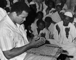 Former boxing champ: Muhammad Ali prays at a mosque in Khartoum, Sudan, in 1988.