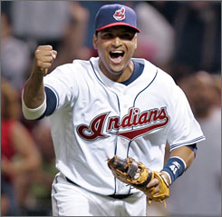 Victor Martinez celebrates after catching the final out in a 5-4-3 triple play in the seventh inning. Martinez also helped Cleveland's offensive cause by cracking his 20th homer in the third.