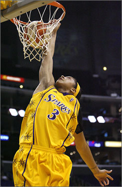 Los Angeles rookie Candace Parker slams down two of her 10 points with 29 seconds left to play against Indiana. Parker joined teammate Lisa Leslie as the only players to dunk in a WNBA game.