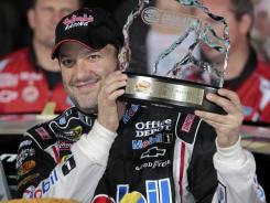 https://i1.wp.com/i.usatoday.net/sports/_photos/2011/10/13/Tony-Stewart-speeds-to-pole-at-Charlotte-UAFL86I-x.jpg