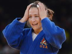 Marti Malloy of the United States celebrates after winning the women's 57 kg judo bronze medal.