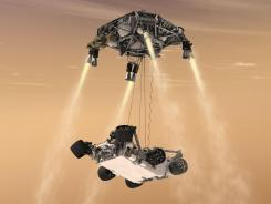In this 2011 artist's rendering, a 'sky crane' lowers the Mars Science Laboratory Curiosity rover onto the surface of Mars.