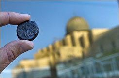 A bronze coin dated by Israeli archaeologists to 69 AD is part of an exhibition in Jerusalem of rare coins excavated at the foot the Temple Mount, found charred and burned from when the Romans razed the Jewish Temple nearly two thousand years ago.
