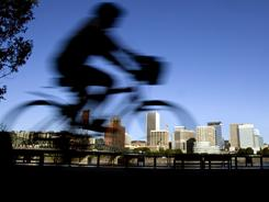 With more than 90 neighborhoods, Portland, Oregon has bike trails, public transportation and green buildings.