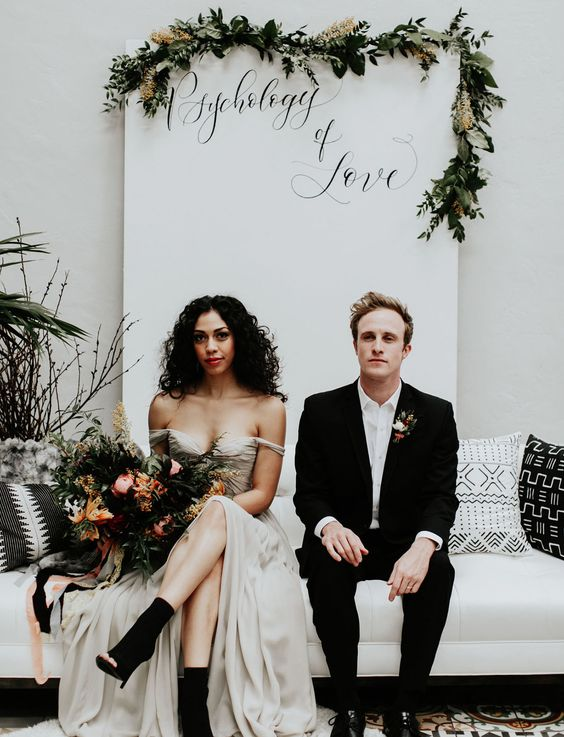 the bride wearing an off the shoulder wedding dress and black peep toe booties