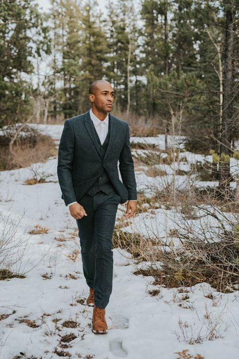 a grey tweed three-piece suit, a white shirt and a tie plus brown boots for a winter wedding