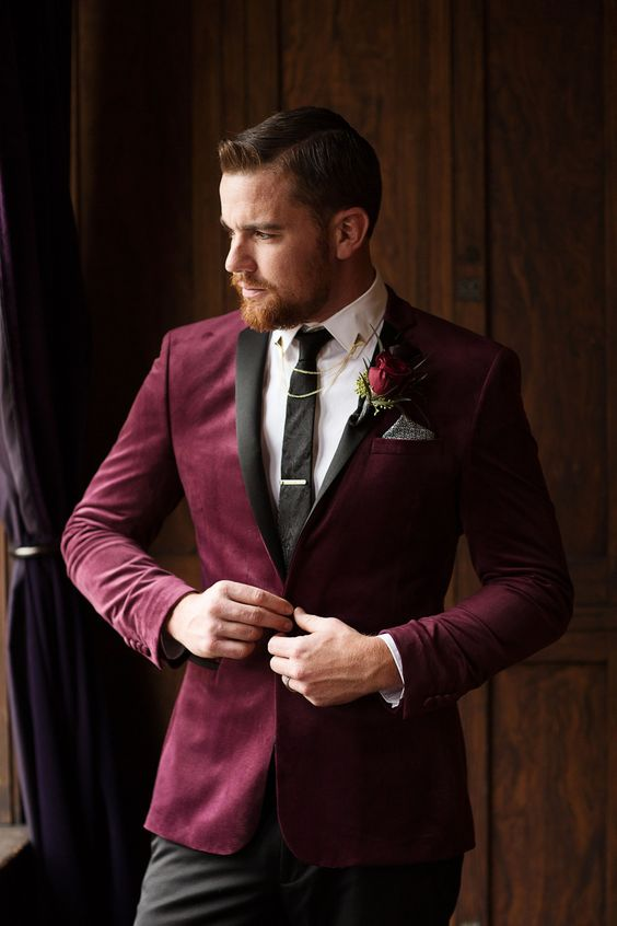 a plum-colored velvet tux, a white button down, a black suit, black pants and some chains for an accent