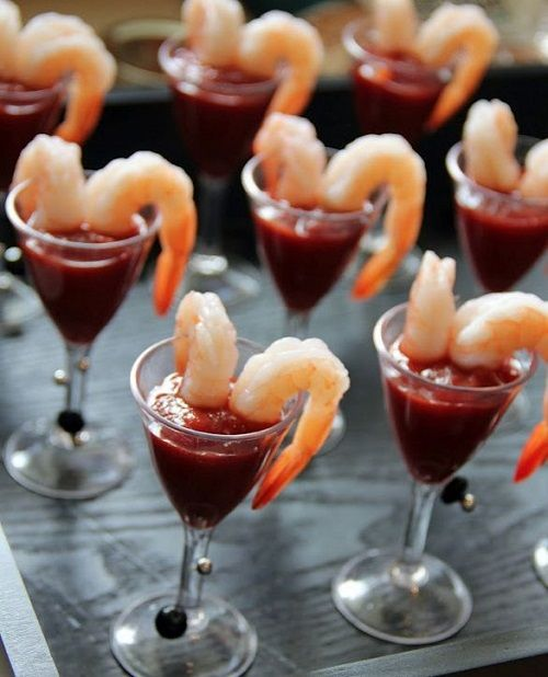 a delicious seafood snack - large shrimps and hot tomato sauce to enjoy