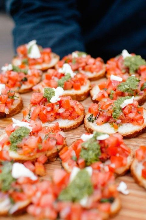 bruschettas with fresh herbs and tomatoes are perfect for vegan weddings, too