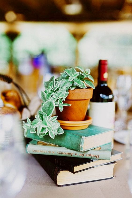 a stack of books with potted cascading greenery on top is an easy DIY idea and is very budget-friendly