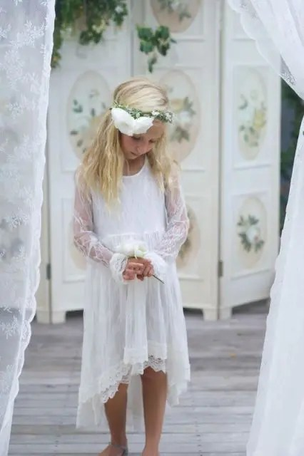 a boho lace high low flower girl dress with a scoop neckline, long sleeves