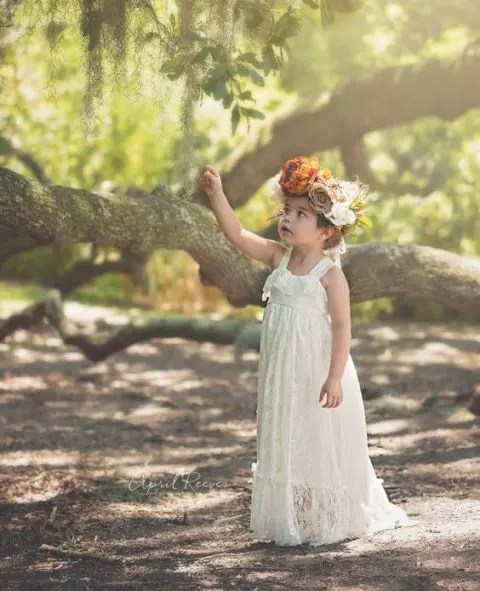 a boho lace maxi flower girl dress with thick straps and a ruffle bodice for a summer wedding