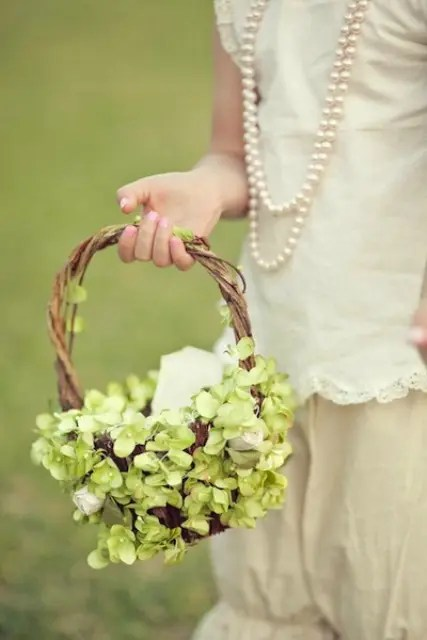 a lovely flower girl basket all covered with green hydrangeas is a great idea with a vintage touch