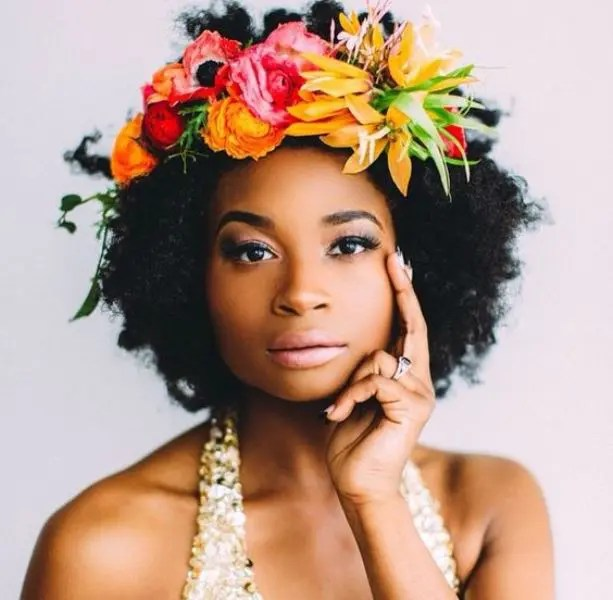 you may highlight your curls with a colorful floral crown, which is a trendy idea
