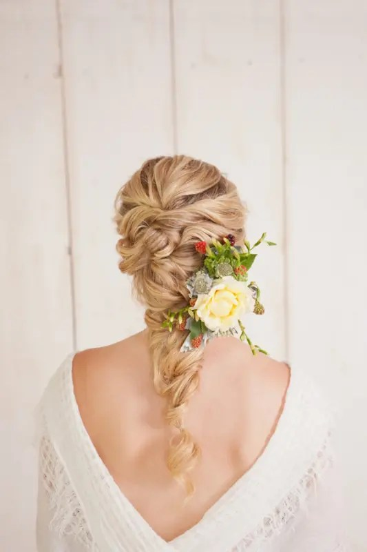 a voluminous curly twisted braid is great for relaxed and boho chic bridal styles