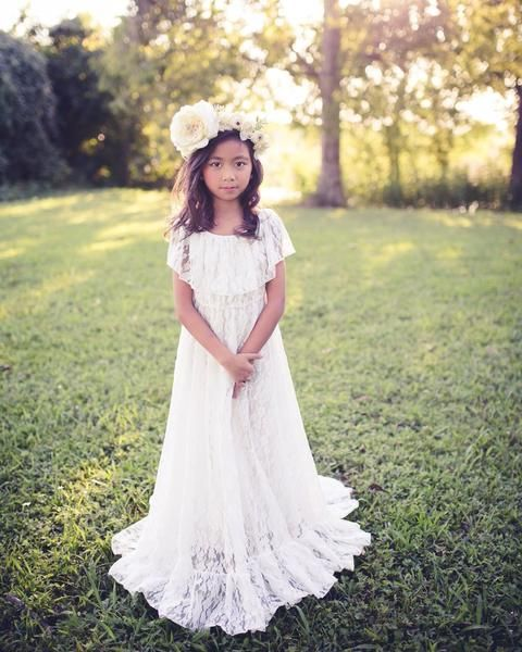 a boho lace maxi dress with a train, with a ruffle bodice and no sleeves, a floral crown for a boho look
