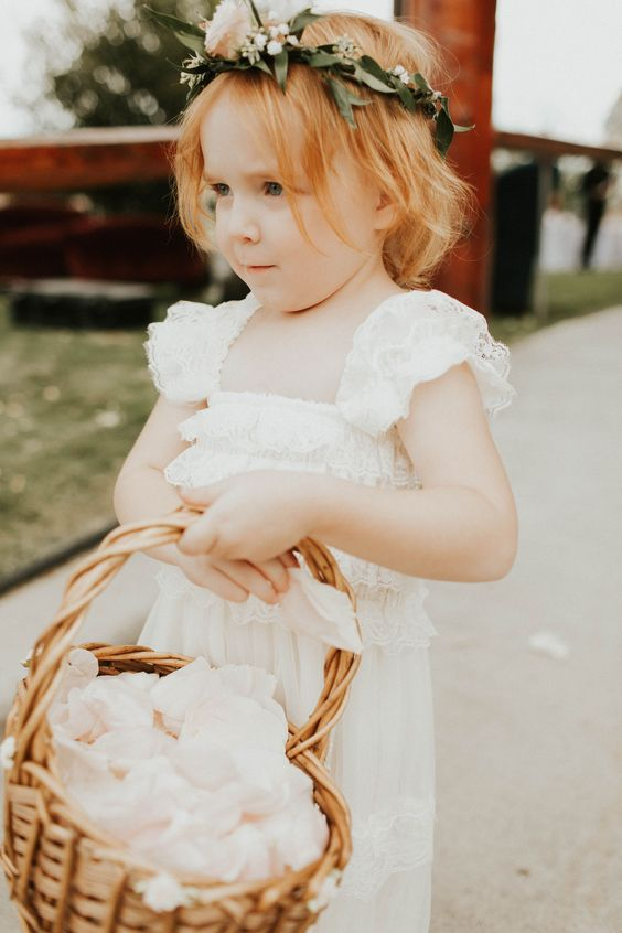 a boho lace maxi flower girl dress with ruffled cap sleeves and a square cut