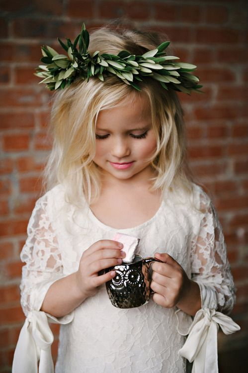 a boho lace sheath flower girl dress with long sleeves with bows and a scoop neckline looks super cute