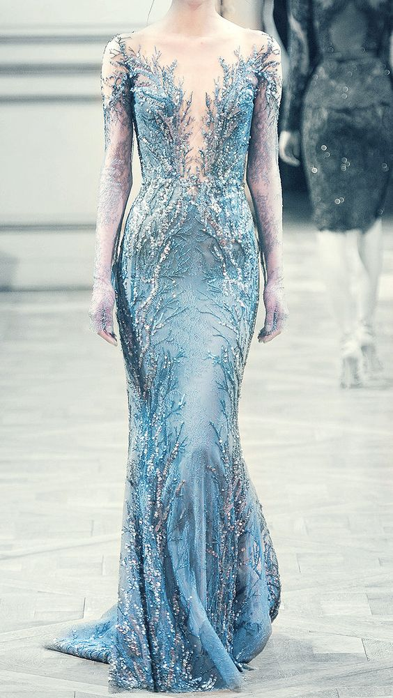 a breathtaking embellished blue sheath wedding dress with an illusion neckline for a Frozen-themed bridla look