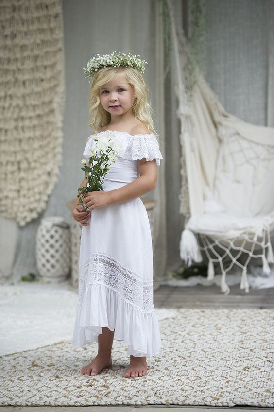 a super cute off the shoulder lace high low flower girl dress with lace inserts and a lace ruffle on the bodice