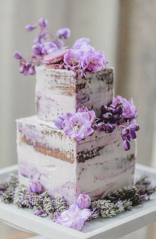 Imagens sobre assexualidade - Página 26 A-naked-square-wedding-cake-with-purple-blooms-herbs-lavender-and-a-purple-macaron-on-top