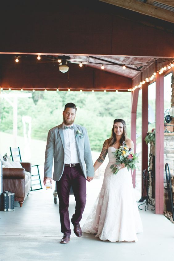 a stylish groom's outfit with a light blue blazer, a white button down, burgundy pants, brown shoes