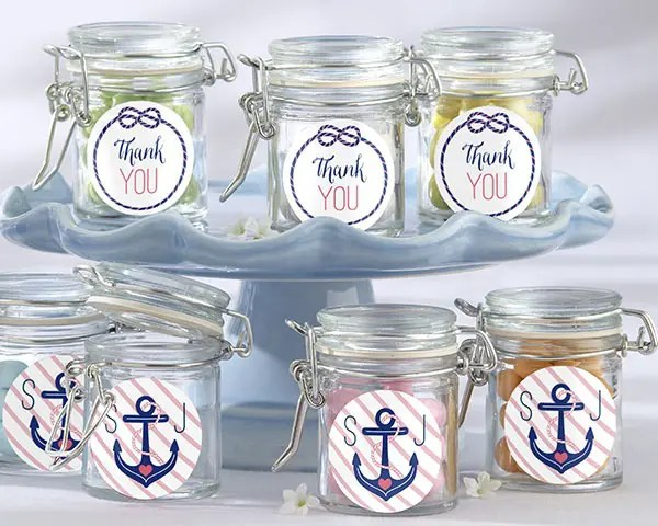 candies packed into stylish jars with anchor stickers are a simple budget-friendly idea for a nautical bridal shower