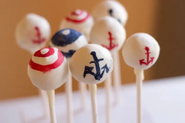 anchor and striped cake pops are perfect for your nautical bridal shower dessert table