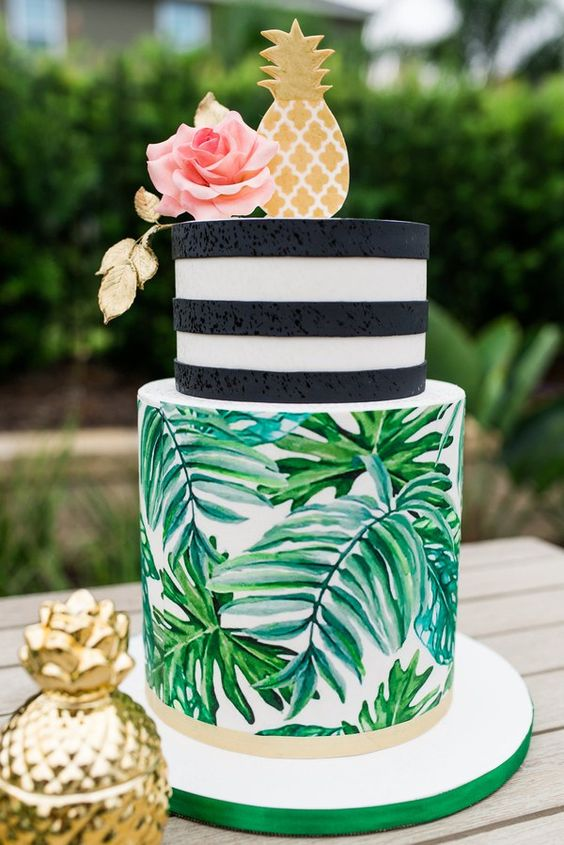 a tropical bridal shower cake with leaves, stripes, a gilded sugar pineapple and a pink rose