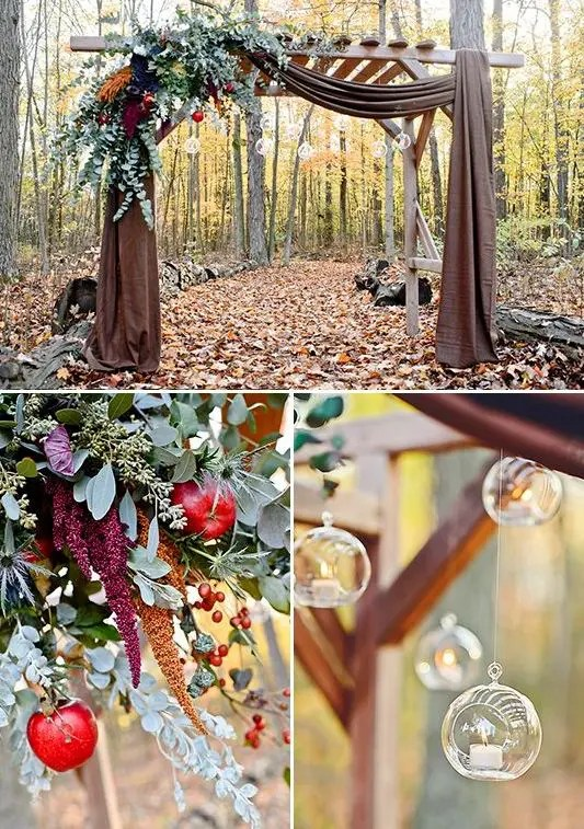 arch decorated with greenery, fruit and hanging candle holders