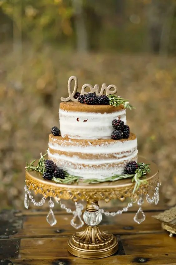 naked fall wedding cake with blackberries