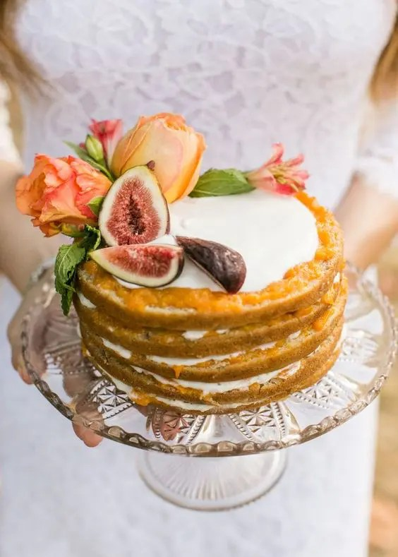 warm colored fig and flower wedding cake