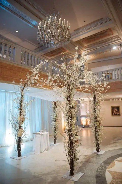 gorgeous white flowers arch creates an impression that it