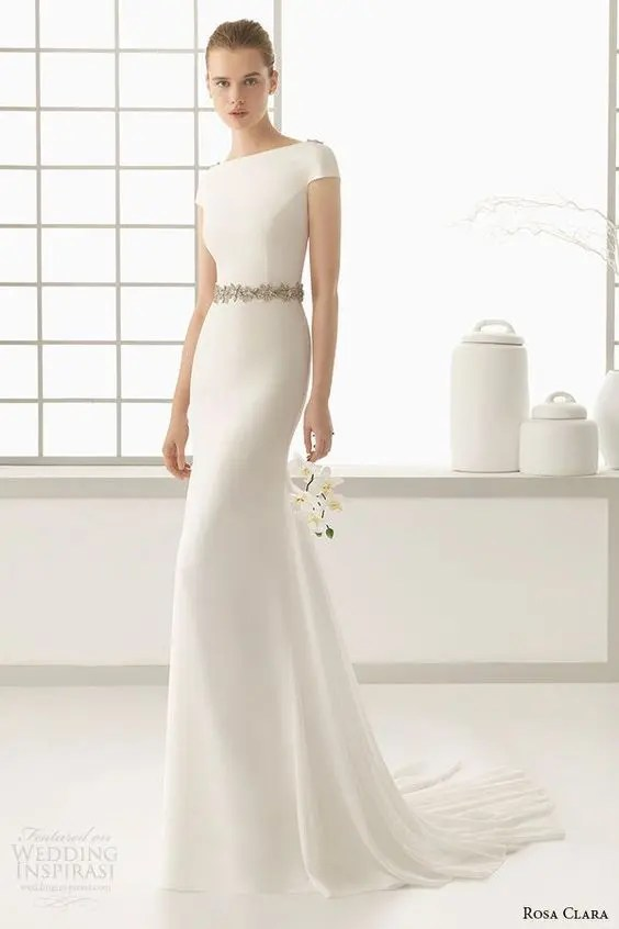 modern wedding dress with a bateau neckline, embellished shoulders and belt