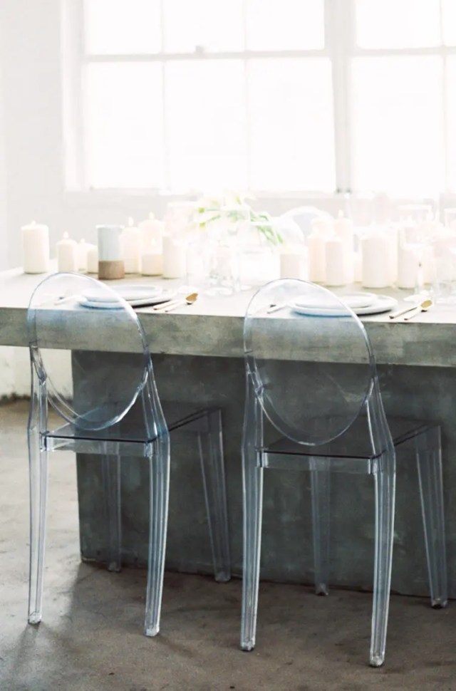 transparent chairs and a concrete table for a minimalist tablescape