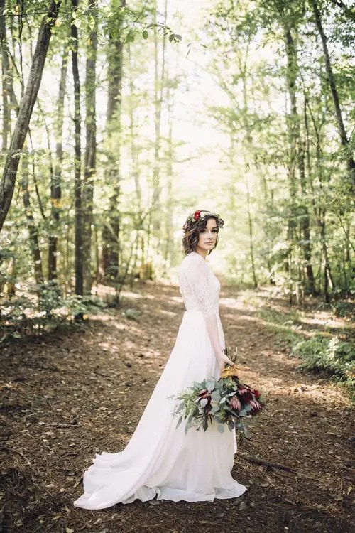 woodland bride going for a walk in the venue