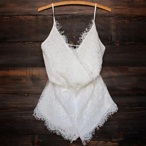 boho ivory lace romper paired with bold shoes and accessories will look amazing