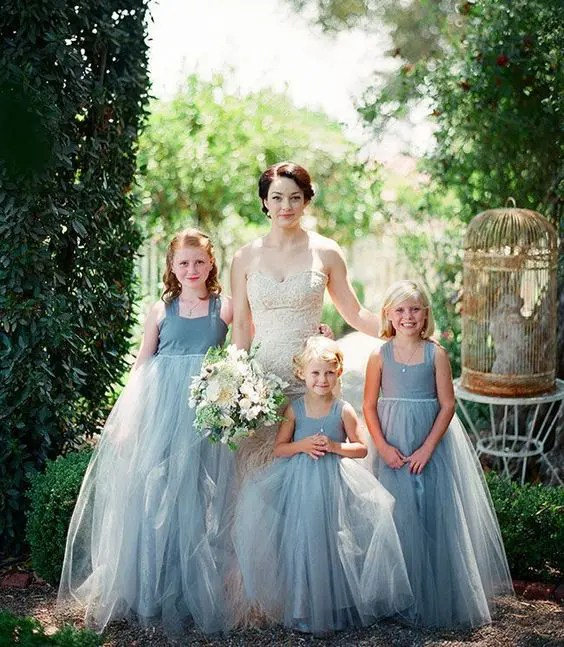 powder blue strap dresses with layered tulle skirts