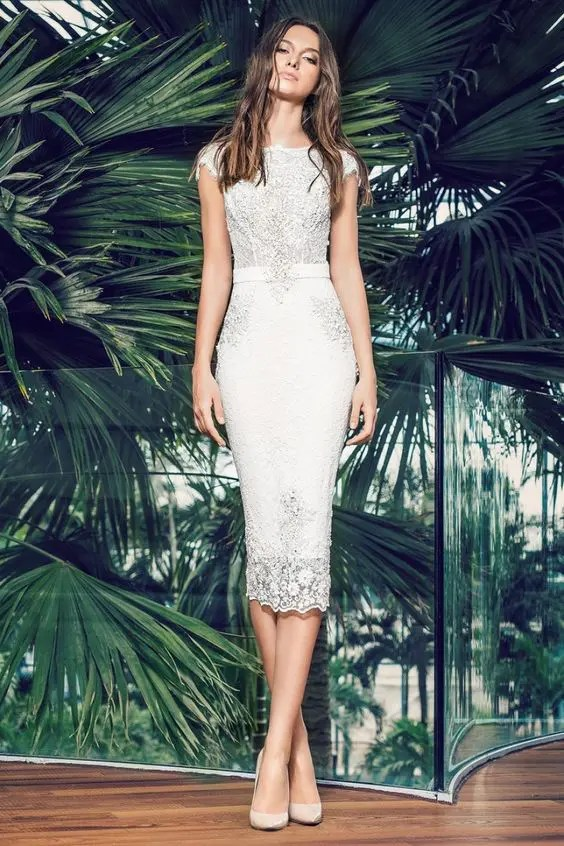 perfectly fitting white lace midi dress with cap sleeves and a sash