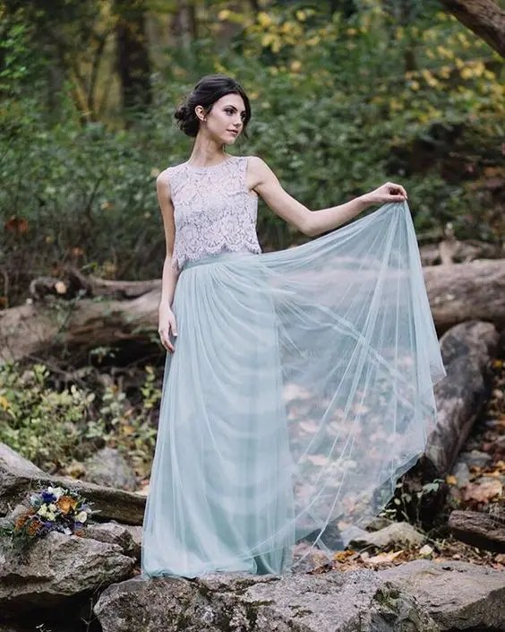 grey tulle maxi skirt with a white sleeveless lace top