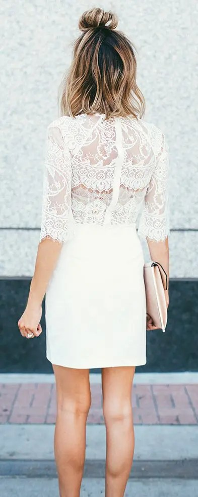 white mini dress with half sleeves, a lace bodice and a plain skirt