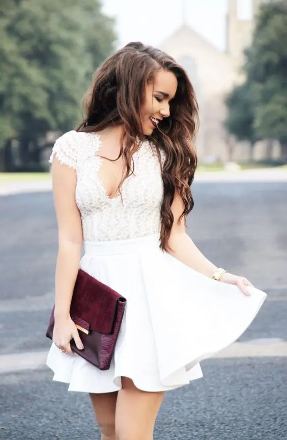 white mini dress with a flare skirt and a lace bodice with cap sleeves and a V-neckline