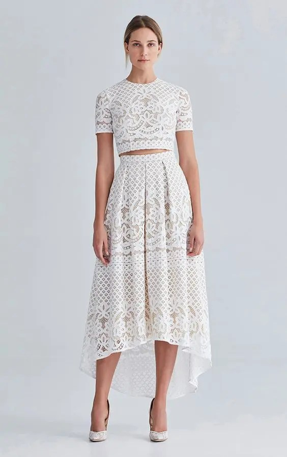 lace separate with a short sleeve crop top and a high low skirt
