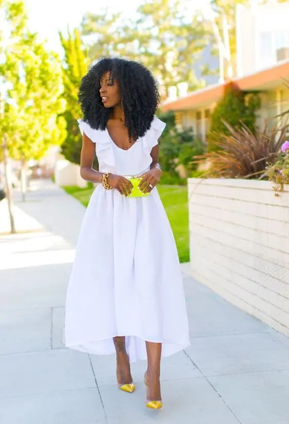 high low midi dress with a ruffle neckline and neon yellow shoes and a clutch