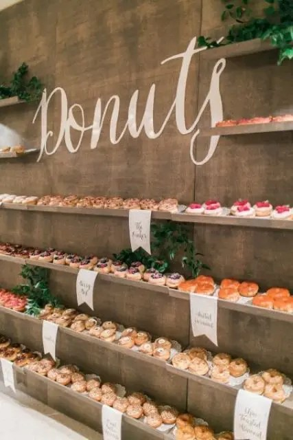 awesome donut bar with desserts displayed on shelves