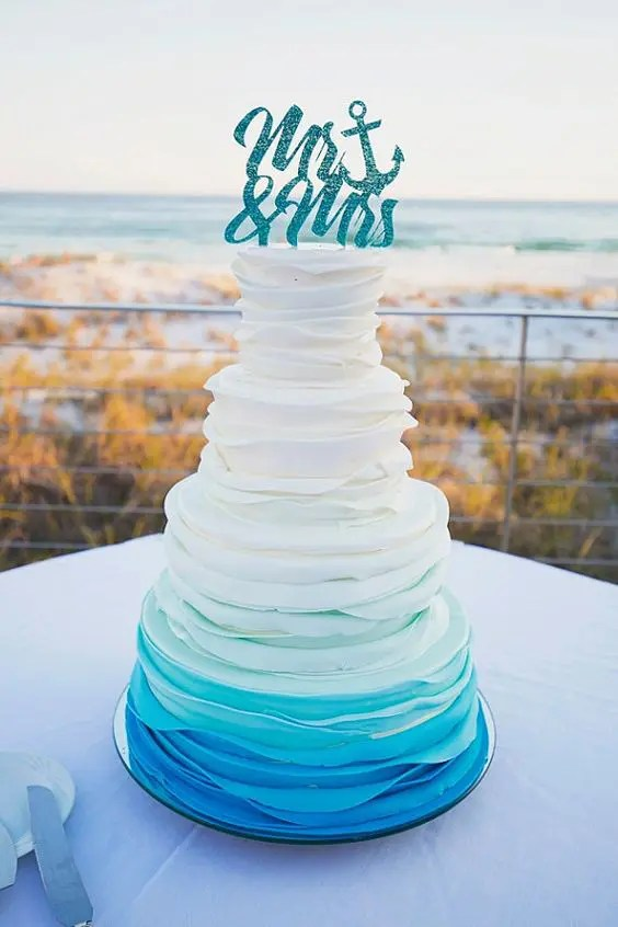 Picture Of ruffle ombre wedding cake in shades of blue and a     ruffle ombre wedding cake in shades of blue and a sparkling cake topper