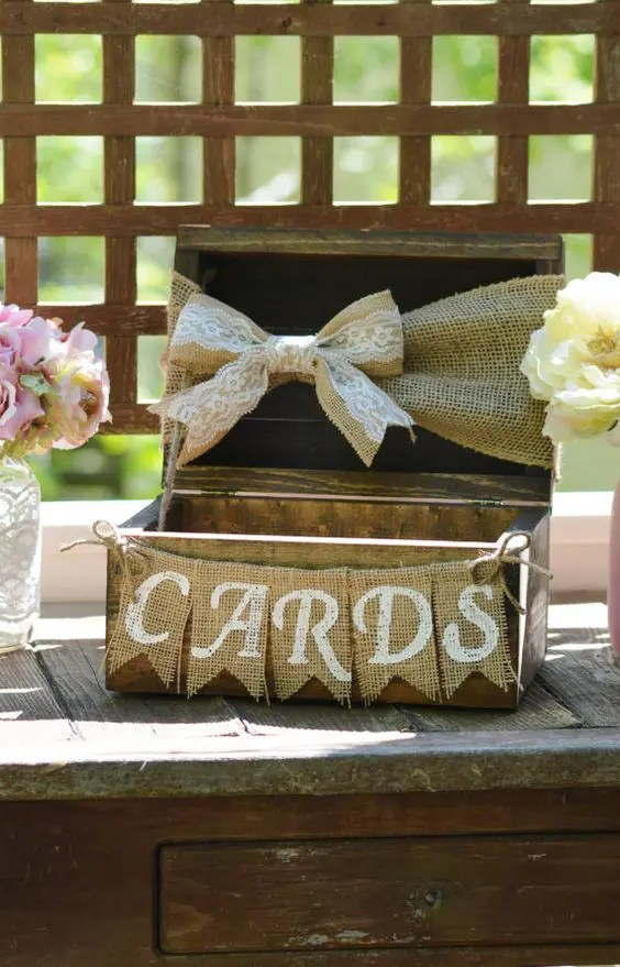 reclaimed wood crate with a burlap banner and a burlap and lace bow