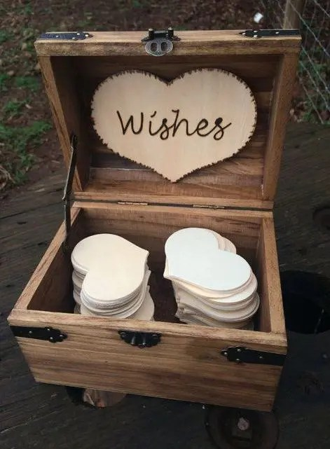 wooden box with a wooden heart and heart-shaped paper