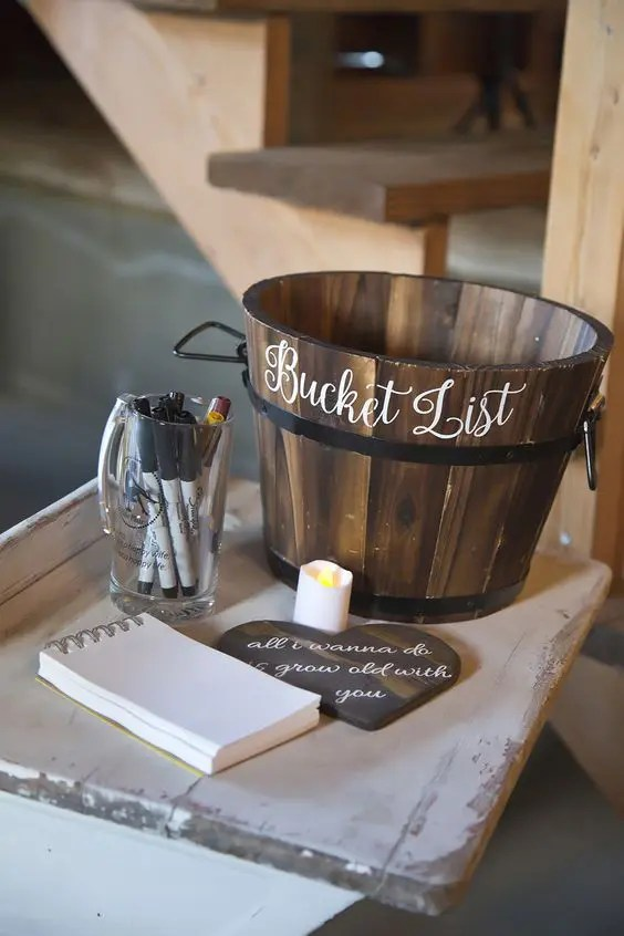wooden bucket for a bucket list is a unique idea
